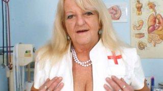 Grandma in uniform spreads blond hairy pussy