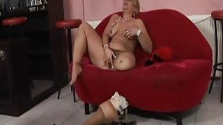 Mature lesbians having great action on the red sofa