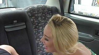 Blonde bangs in cab in hidden car park