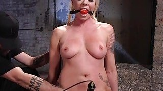 Tied blonde slave has tough torment