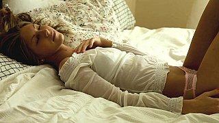 Angelika masturbating on a bed