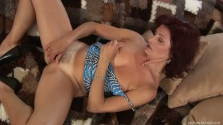 Mature hooker Wanda treats her hairy cunt with big blue vibrator