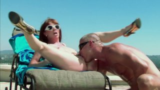 Horny redhead Rayveness rides beach guard and gets cumshot on her face