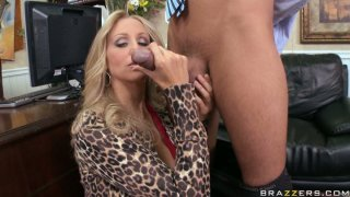Vamp slut Julia Ann gives a tremendous blowjob to Keiran Lee in the office